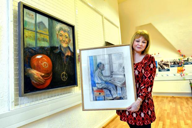 ROLE: Diane Hadwen, manager of the Peace Museum, holds a painting of music hall  legend Donald Swan