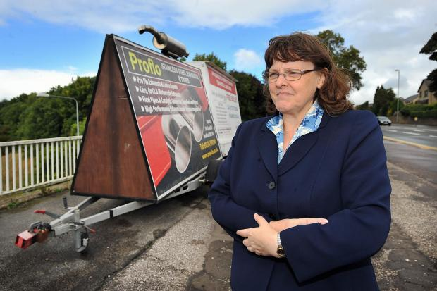 Campaign: Councillor Liz Smaje with a hoarding parked on a bridge across the M62 in September