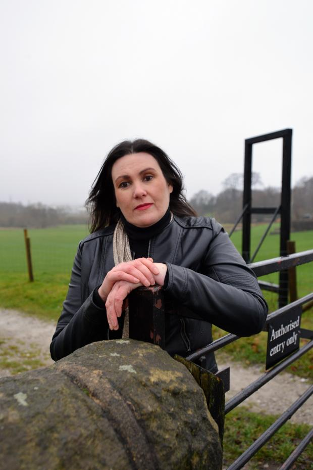 Bradford Telegraph and Argus: Andrea Jones at the gate where the thieves broke in