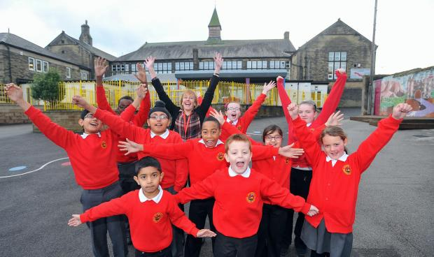 Allerton primary pupils and assistant headteacher Jenny Wilson celebrate their school's achievements