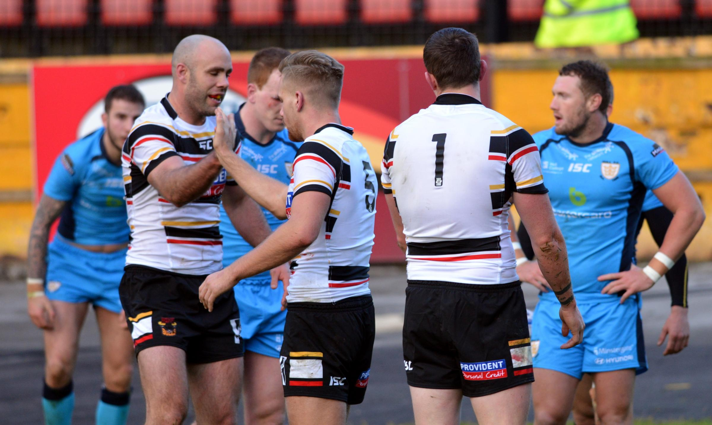 Fellow try-scorer Adrian Purtell, left, congratulates Jamie Foster on crossing for the Bulls against Hull FC