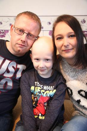 Cancer patient Callum Ingham, eight, with his mum Kim Ager and dad Matthew Ingham