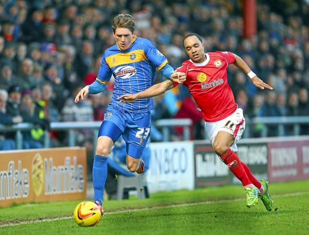 Adam Reach, left, in action for Shrewsbury against Crewe during a loan spell earlier in the season – Picture: Catherine Ivill/AMA