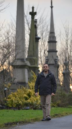 Coun Hassan Khan in the cemetery