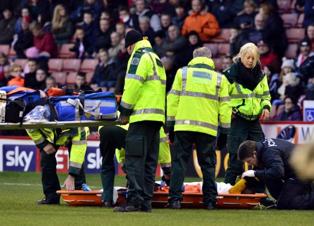 Bradford Telegraph and Argus: Medics tend to stricken City winger Kyel Reid after his season-ending knee injury at Sheffield United