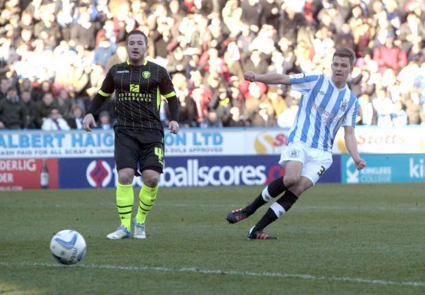 STRIKE ONE: Leeds hitman Ross McCormack looks on as Chris Atkinson scores his first goal for Huddersfield in a 4-2 home defeat against their derby foes on December 1, 2012