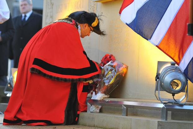 DEDICATION: The Lord Mayor of Bradford Coun Khadim Hussain lays a tribute at the new memorial during the service