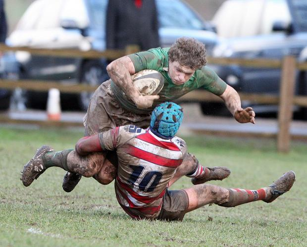 Wharfedale's young hooker Dan Stockdale is well tackled by Rosslyn Park fly half Scott Sneddon last Saturday