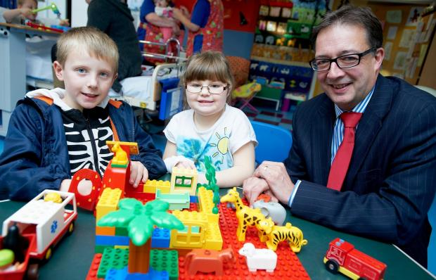 Neil Shaw of LCF Law with a couple of young Airedale hospital patients Skyler Carrol, Shannon Mchale