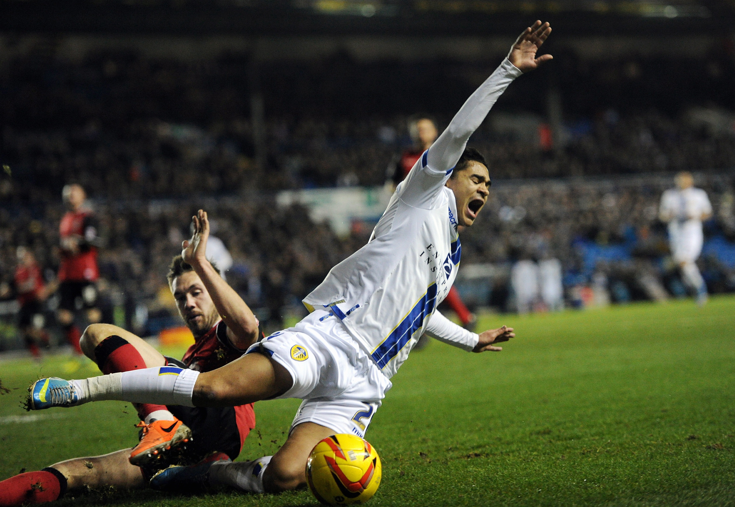 Action from Leeds' 1-1 draw in midweek against Ipswich. The club's struggles on the pitch will not be helped by news the proposed takeover by Sport Capita