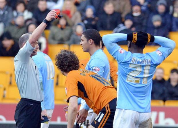 Referee Scott Duncan shows City midfielder Nathan Doyle a red card as they were reduced to ten men during the first half of a 2-0 defeat at Wolves