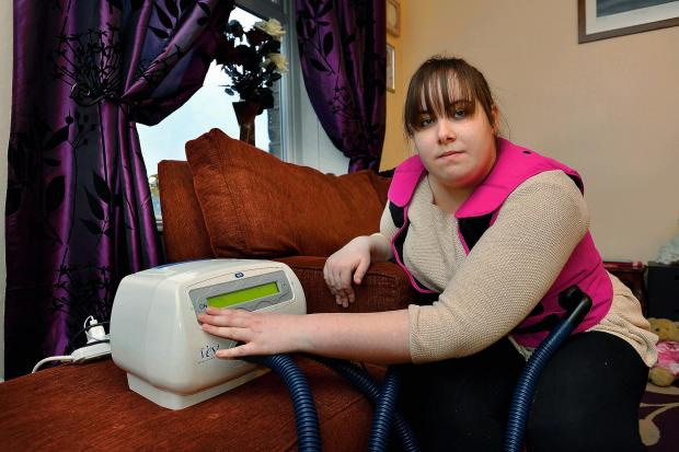 Holly May Humphrey with The Vest, which helps her control the effects of a lung condition