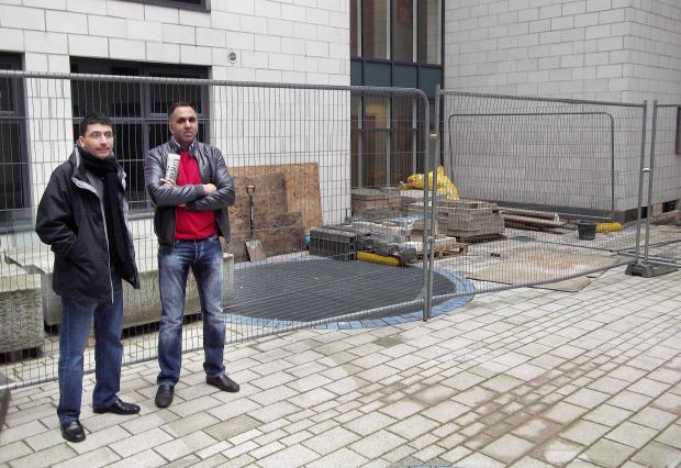 Bradford Telegraph and Argus: Gatehaus Owners Association members Jamil Ashraf and Inderjit Athwal in the courtyard