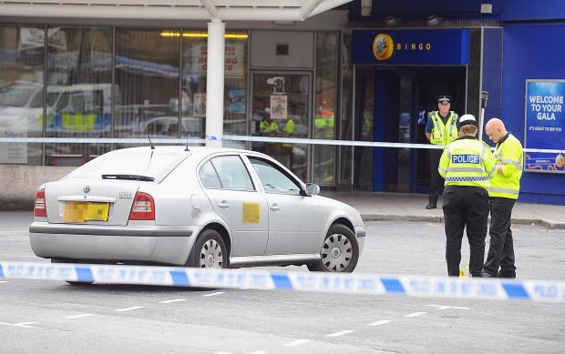 Police officers attend the scene of the incident at Bradford Interchange