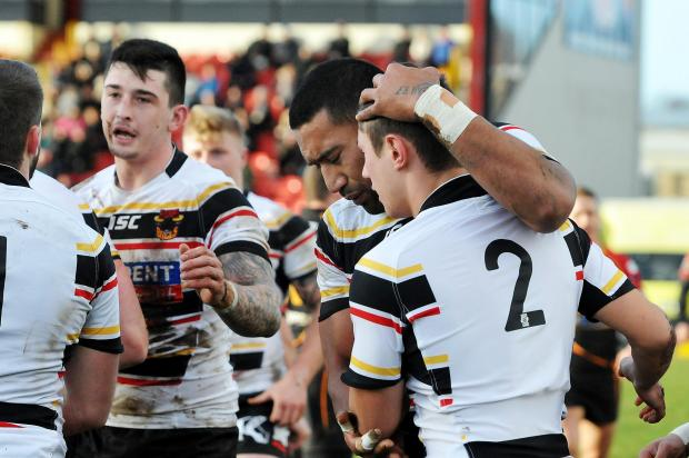 Bradford Telegraph and Argus: James Saltonstall is congratulated after scoring for the Bulls in their pre-season friendly against Dewsbury