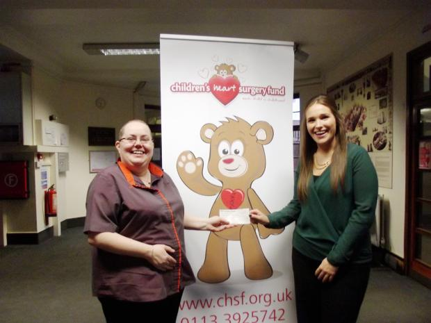 Kate is pictured handing over the proceeds of her sponsored head shave to Debbie Field, of the Children's Heart Surgery Fund