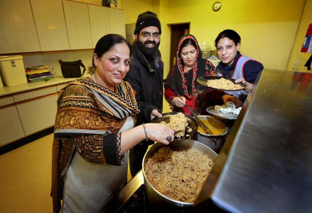 Bradford Telegraph and Argus: UNITED: Bradford Unites in Disaster is setting up a kitchen offering free food. From left, Shabana Begum, Mohammed Shakeel, Latif Fatima, and Nighat Qadir