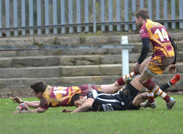 Bradford Telegraph and Argus: Nazir Karim goes over for Otley's try