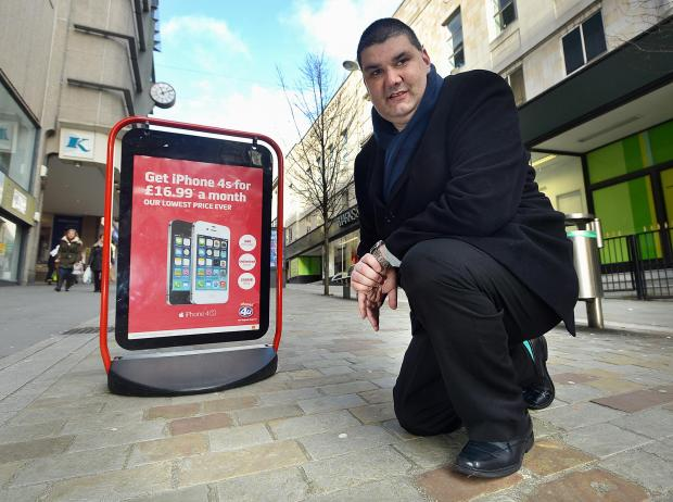 Bradford Telegraph and Argus: Emerson Walgrove, of Bradford and District Disabled People's Forum, with one of the A-Boards which he says are a hazard to the blind or partially sighted people and aren't always in the same place each day
