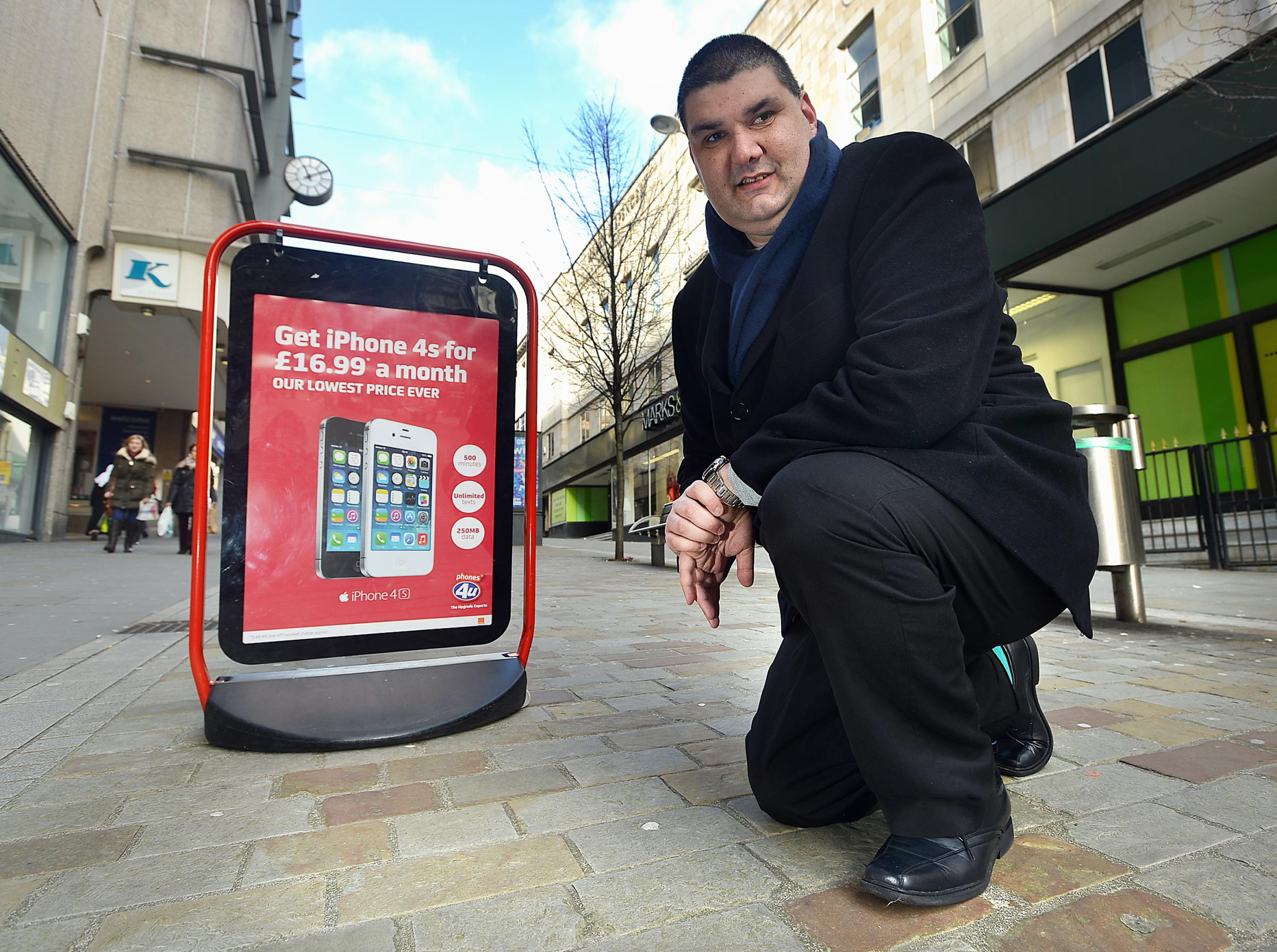 Emerson Walgrove, of Bradford and District Disabled People's Forum, with one of the A-Boards which he says are a hazard to the blind or partially sighted people and aren't always in the same place each day