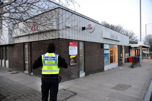 Bradford Telegraph and Argus: Police at the scene of the robbery