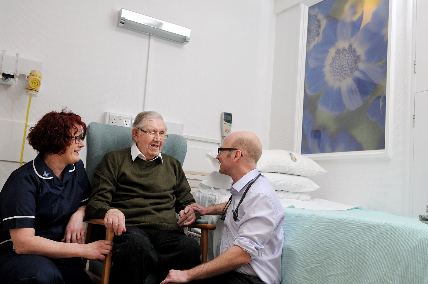 Ward sister Sarah Robinson with patient Ronald Ford and consultant Robert Marshall