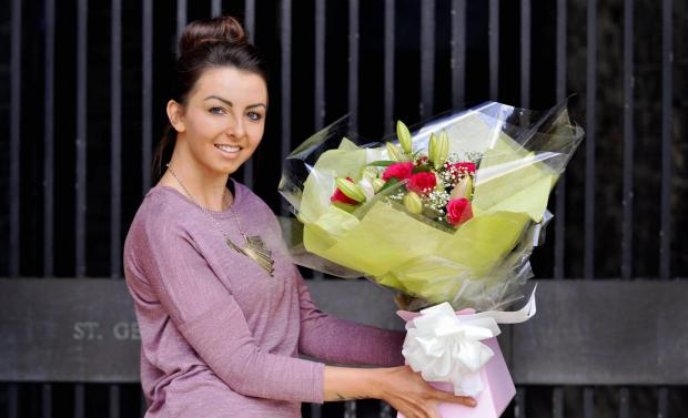 Florist Hayley Sagar from Floral Occasions in Bradford city centre with a bouquet of Valentine's flowers