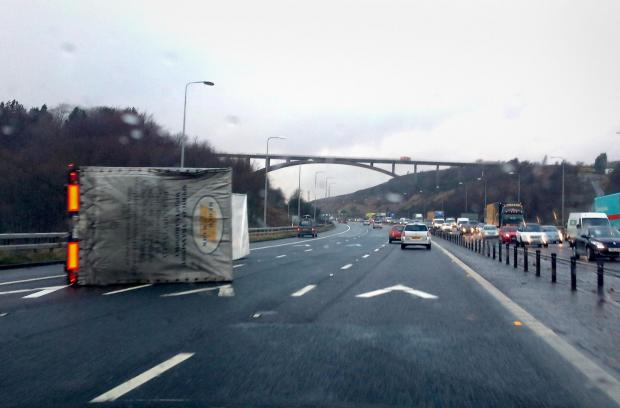 The overturned lorry on the M62