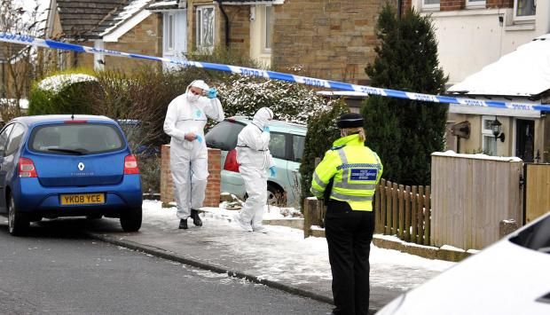 Police at the scene of the murder in keighley