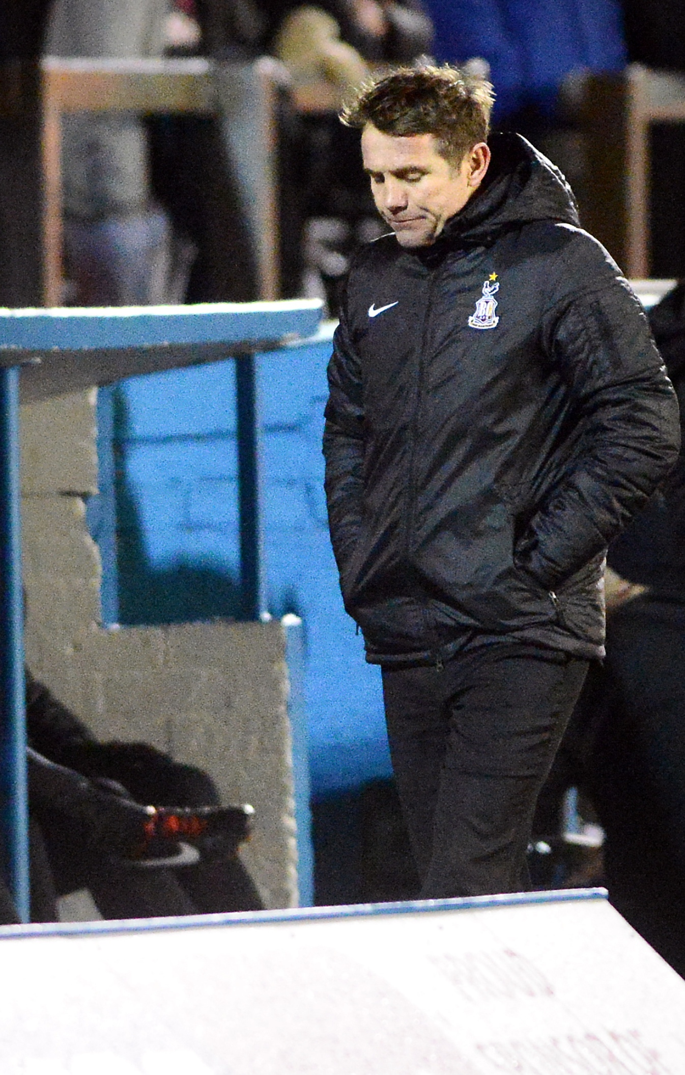 EYES DOWN: Phil Parkinson looks a dejected figure after the Carlisle defeat but the Bantams boss is determined to end City's slump