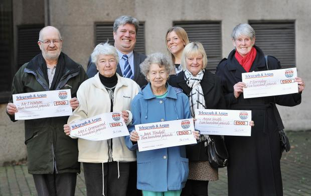 Damian Holmes and Charlotte from the Telegraph & Argus with the winners of the heating competition Ian Watson, Cyn Greenwood, Jean Tindall, Anne Smith and Jean Ferriday