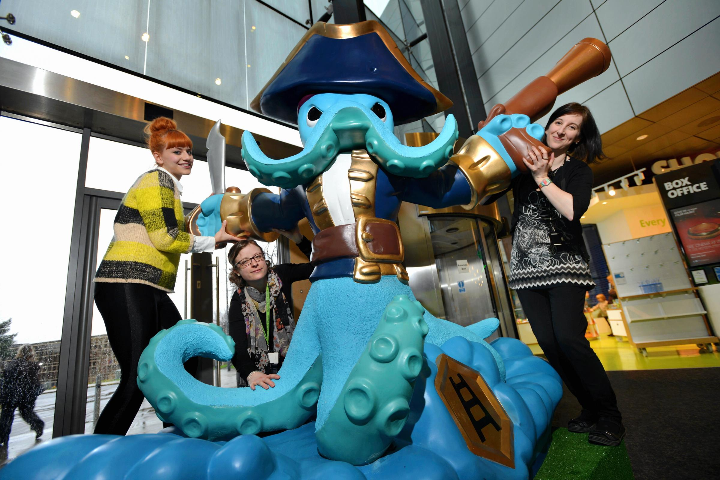STATUE: Pictured with Skylander are (from left) Sophie Loftus, Heather Johnson and Anna Ward from the museum
