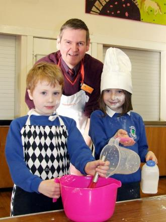 Sainsbury's baker Mike Armstrong with Louis Stephens and Agatha Stanbury at Oakworth Primary School