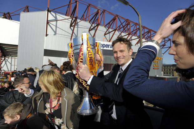 Phil Parkinson shows off the League Two play-off trophy last season