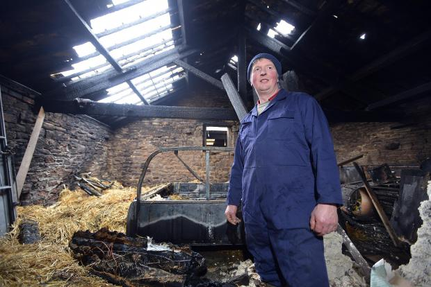 Farmer David Gawthorp in the fire-damaged barn at Chellow Heights Farm, where 25 firefighters tackled a blaze
