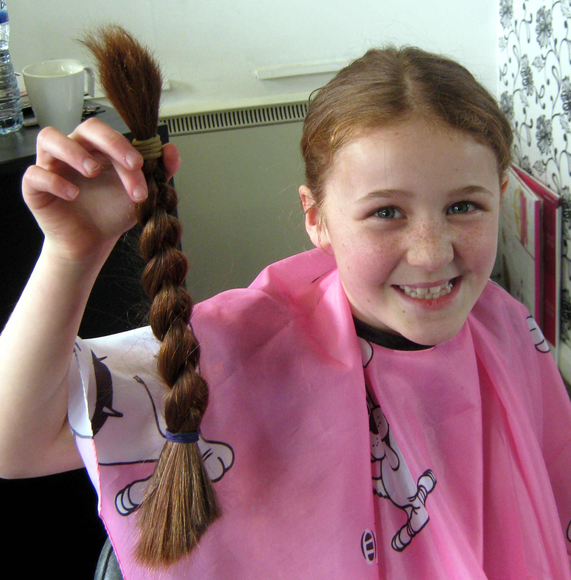 Megan Lister, nine, who had her long hair chopped off to help raise money for schools in Africa