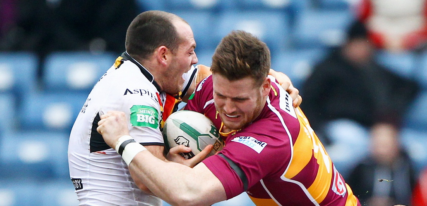 Anthony Mullally is tackled by Heath L'Estrange during Huddersfield's home clash with the Bulls last season