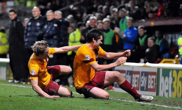 Bradford Telegraph and Argus: Carl McHugh, right, on a victory slide with Stephen Darby