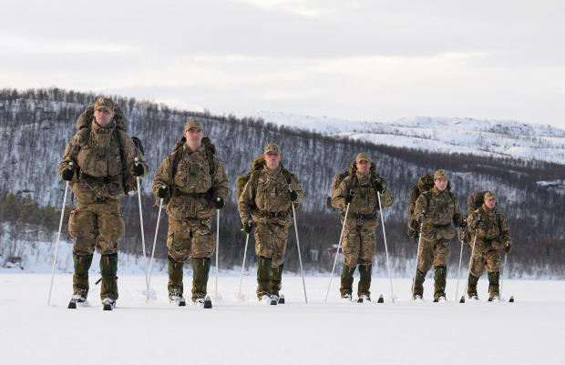 From left, Corporal Tom Rounding, Corporal Anthony Fairclough, Marine Tom Barker, Colour Sergeant Richard Hayden, Captain Samuel Moreton and Lance Corporal Matt Robb ski across a frozen lake near Bardufoss in northern Norway during phase one of the Royal