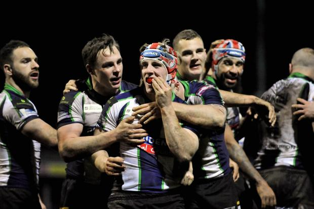 Bulls players congratulate Adam O'Brien after his try ended any doubt about last night's result