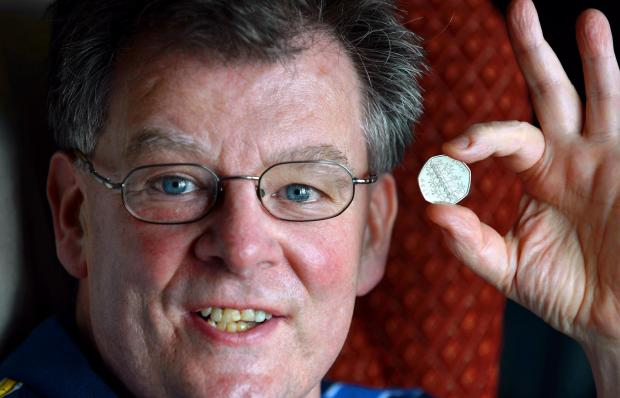 Christopher Fisher with the valuable 50p coin which he found in a drawer