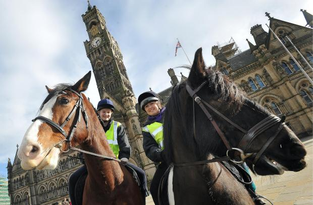 Riders Nicole Fairbank and Abigail Wheeler on horseback outside City Hall earlier this year to protest at the plan