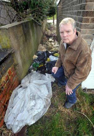 Terry Hatfield and some of the flytipped rubbish