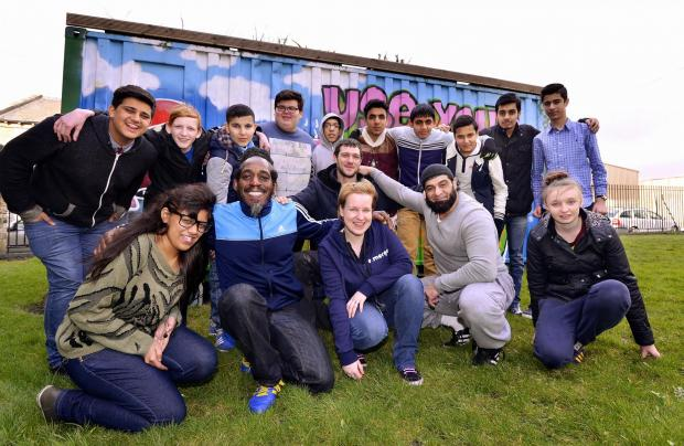 Desmond Henry, Damon Scully and Rashid Khan (front) with youth worker Emma Bonfield and others at the event