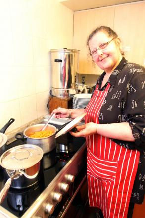 Irene Cyhanko with the new cooker at the centre