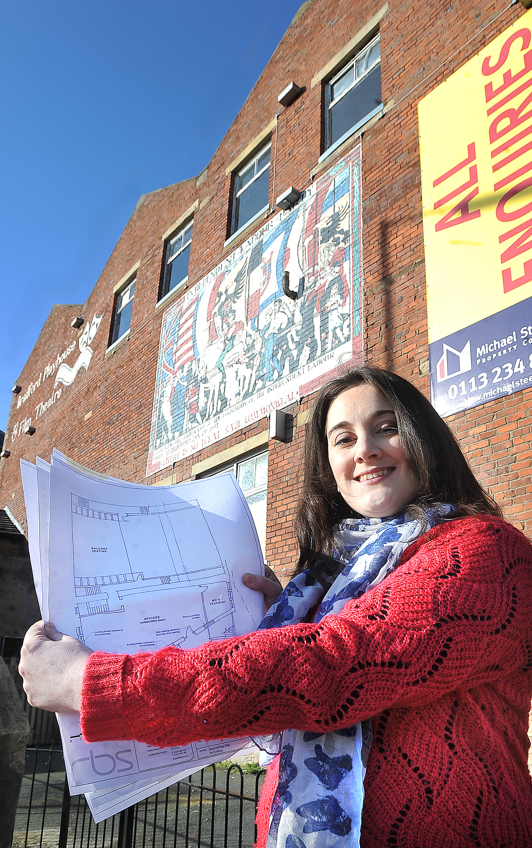 Clare Gadsby, outside the Playhouse, with some of the drawings