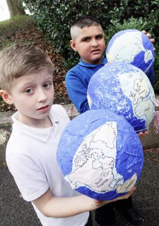 Oakworth Primary School pupils Paddy Moran (left), eight, and Asim Khan, seven, get a global view during the Fairtrade event