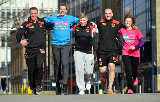 Epilepsy Action's Carl Foster (second from left) and Claudia Christie (right) are joined by Bradford Bulls players Tom Olbison, Danny Addy and Dale Ferguson