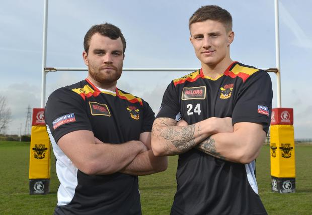 WELCOME ABOARD: Greg Burke, left, and Liam Sutcliffe pose for our snapper at the Bulls' training ground yesterday