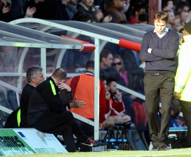 City boss Phil Parkinson shows his disappointment after his side concede a second goal at Brentford